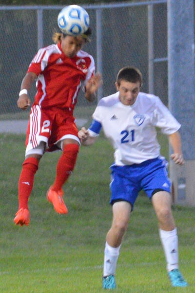 Junior Anthony Bil wins a header vs FC player in the first half. Anthony scored later in the second half.