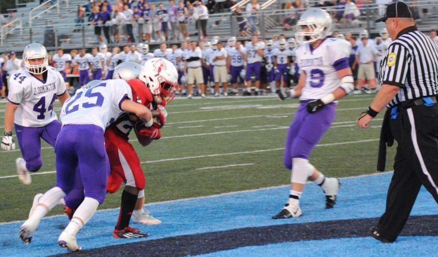 Senior+Cardell+Tucker+Plows+his+way+for+a+touchdown.+Tucker+was+injured+later+in+the+game.