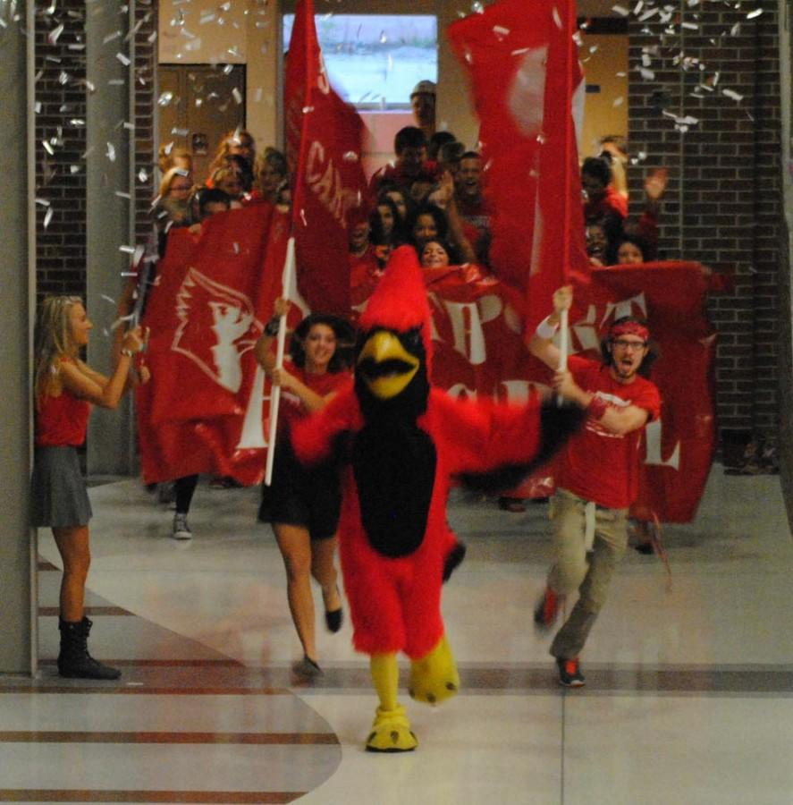 Booster Club forms 'Red Sea' for football video