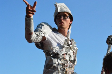 During the parade on Sept. 19, junior Cooper Davis points into the distance.