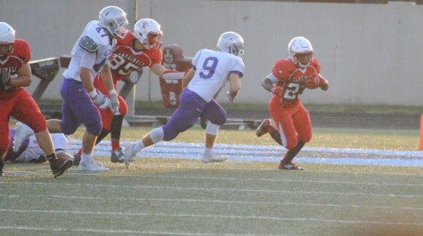 During the Homecoming game on Sept. 19, senior Cardell Tucker dodges a defender.