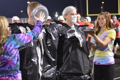 Junior Madison Crosley smiles in excitement after she finishes pieing O'Connor.