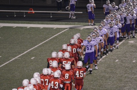 The SHS Cards shake hands with players from Bloomington South.
