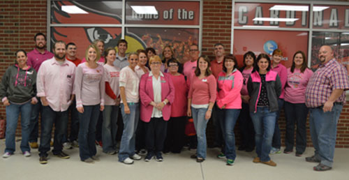 Some of the many faculty members dressed in pink pose after school on Oct. 29.