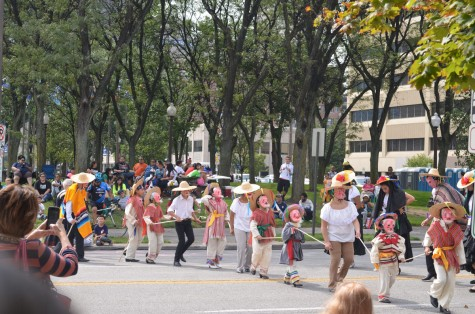 Children performed a dance with adults. They performed with masks symbolizing elderly people.