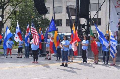 The national anthem was played at the festival near the stage. Flags from various Latin American countries were represented.