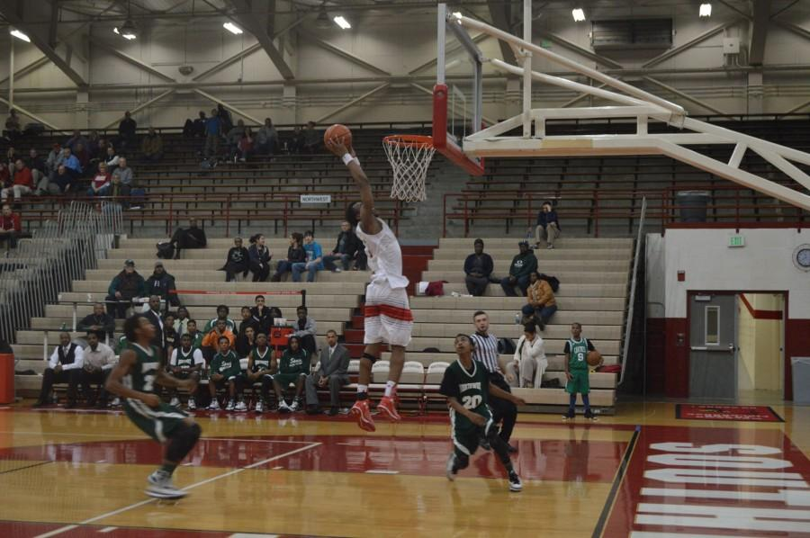 Sophomore Paul Scruggs attempts to dunk on Tuesday Dec. 16. Scruggs shared leading the team in scoring with 13 points.