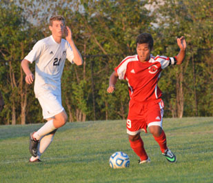 Senior Van Lian dribbles past a Perry Meridian player on September 4, 2014.  Lian scored two goals that game and Southport won 3-2.
