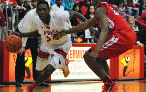 Junior Eli Walton breaks past a Pike defender. Walton fouled out in the fourth overtime in the 92-86 loss.