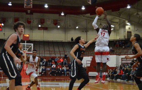 Senior Malik Bennett pulls up for a jump shot while being covered by a Park Tudor defender. Bennett attended Pike during his freshman season.
