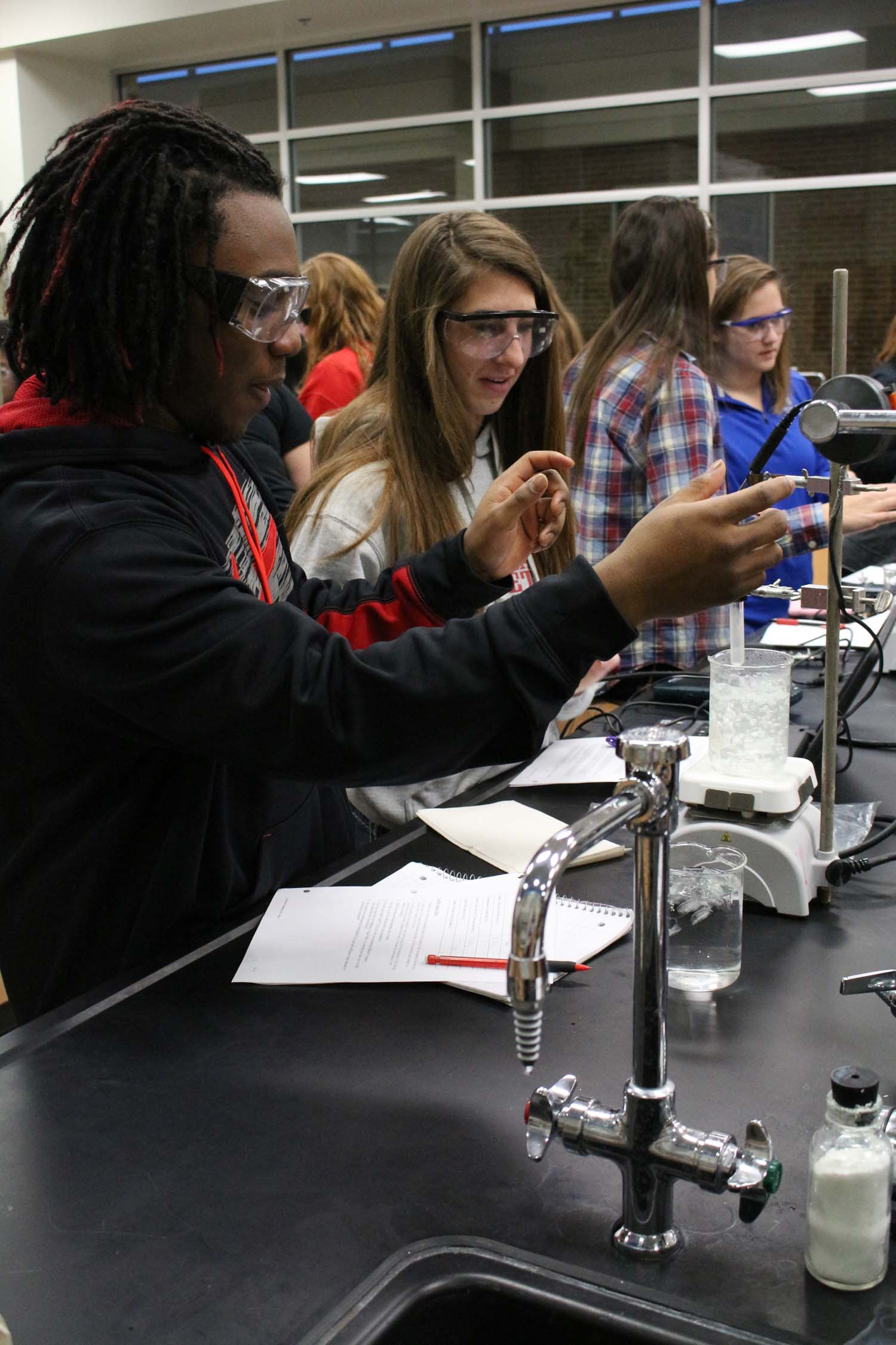 Senior Cardell Tucker and junior Lexi Van Baale measure the temperature of water for a lab on Jan. 22.