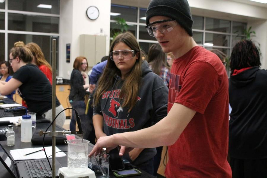 Junior Arizona Hinkle and senior Jonathan Gritt measure the temperature of water for a chemistry lab on Jan. 22.