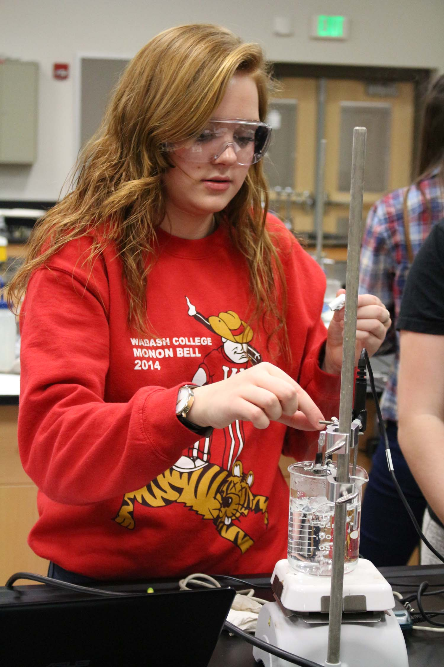 Junior Jaclyn Boyer tests a solution for a chemistry lab on Jan. 22.