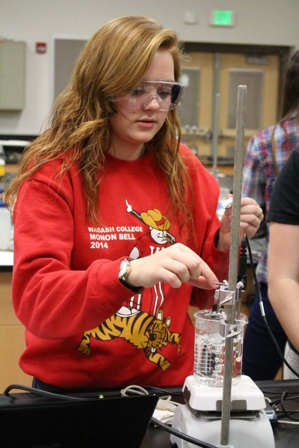 Junior Jaclyn Boyer tests the solution for a lab on Jan. 22.
