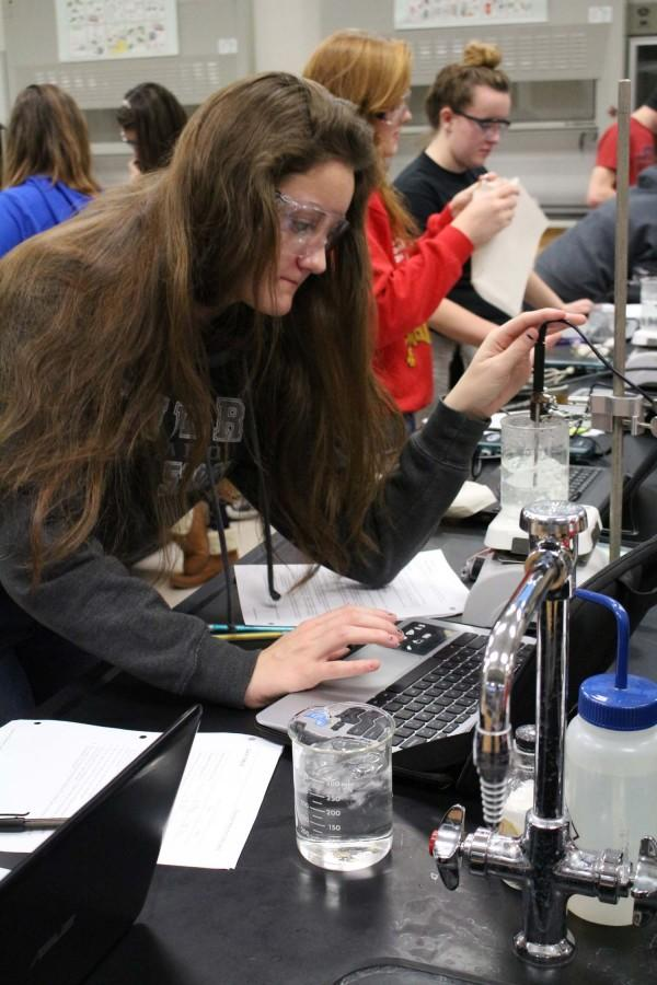Junior Kayla Fox uses her Chromebook for a chemistry lab on Jan. 22.