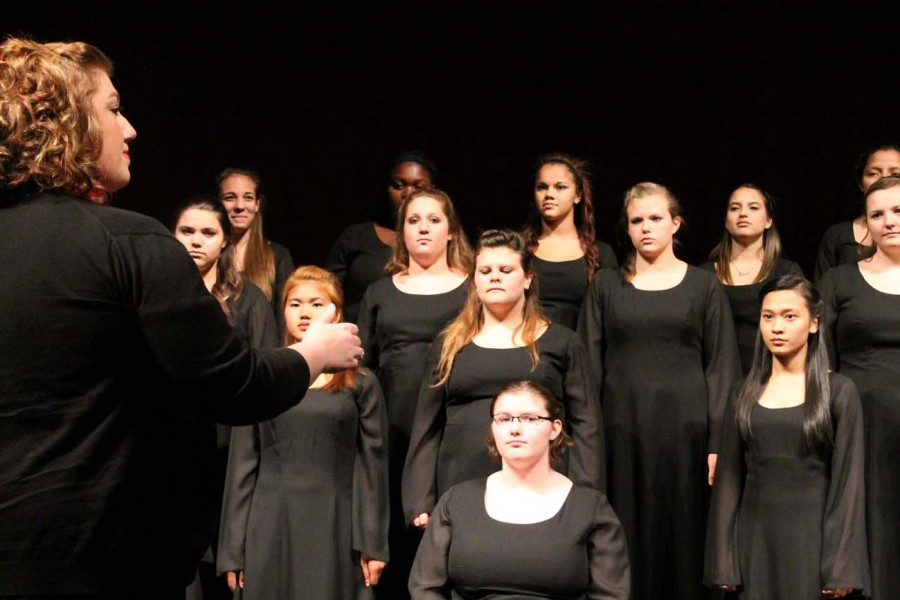Choir teacher Ms. Katherine Doty directs the students during the choir concert. The concert was held on September 23rd.