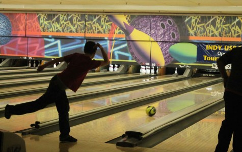 Austin Isaac '16 is rolling the bowling ball at practice. He bowled a perfect strike.