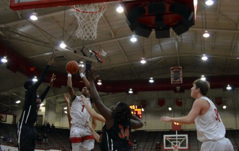 Sophomore Paul Scruggs attempts to shoot a lay up during the county quarter finals versus Park Tudor. Scruggs lead the team with 17 points.