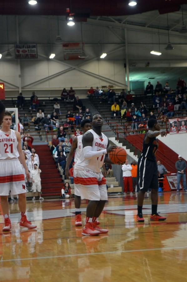 Senior Malik Bennett shoots his second free throw against the Park Tudor Panther on Wed. Jan 14. Bennett did not miss a free throw.