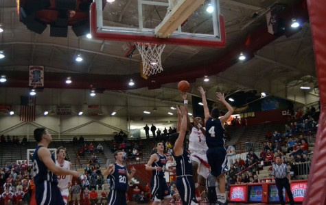 Sophomore Paul Scruggs shoots a floater during the game against Bedford North Lawrence. Scruggs had a career high 36 points during the game.