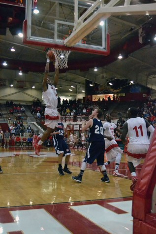 Sophomore Paul Scruggs attempts to dunk the ball against Bedford North Lawrence. Scruggs had 36 points that night and 10 rebounds 8 assists and five steals.