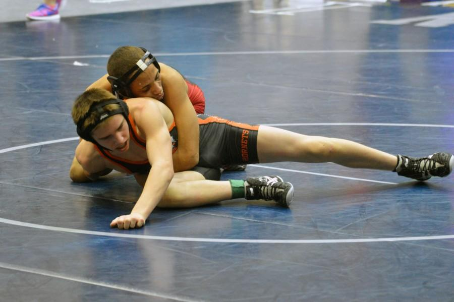 Senior+Dameion+Rutledge+attempts+to+pin+his+opponent+at+the+regional+competition.+Rutledge+has+moved+on+to+the+semi-state+championship+on+Sat.+Feb.+14.