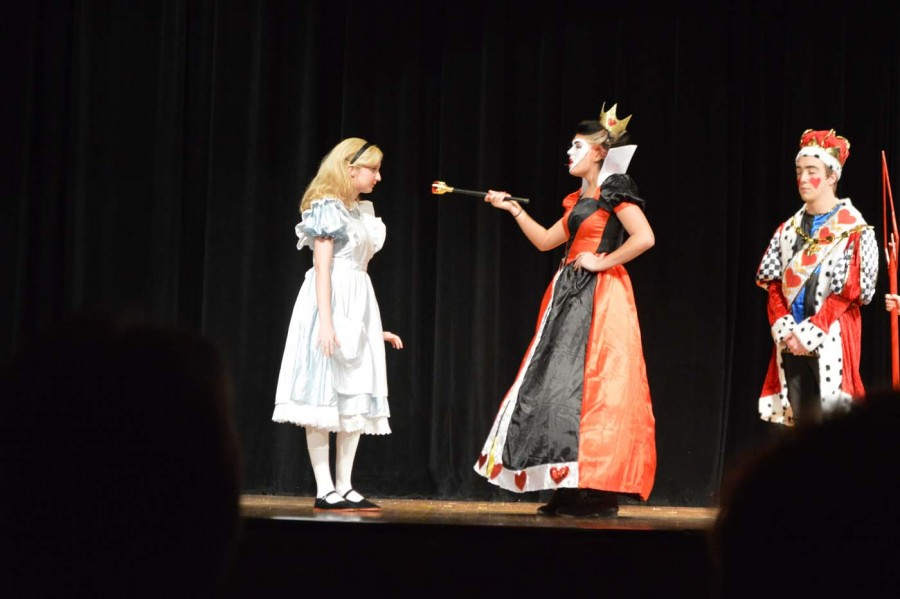 Alice (senior Paige Kidwell) and the Queen of Hearts (senior Lily Freese) exchange words during the Thursday night performance on March 5.