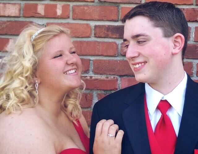 Kibby and Fields smiling together before prom last year. The couple has endured a long-distance relationship since summer, 2014.