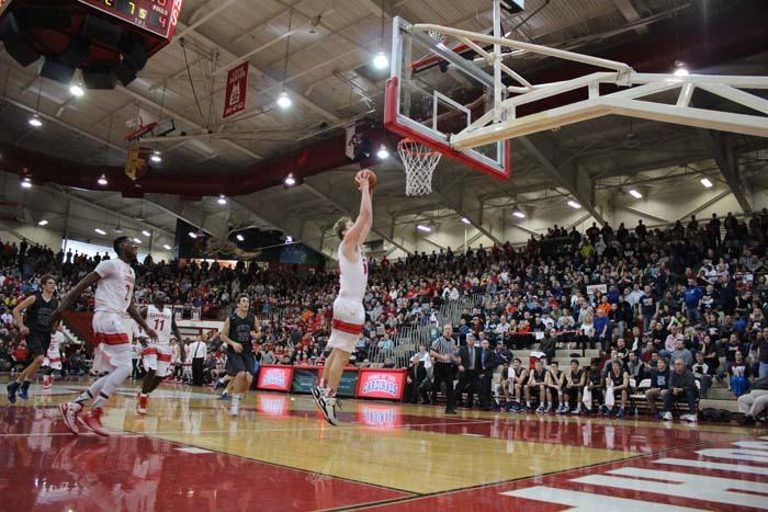 Junior Joey Brunk goes up to dunk on Feb. 28 against Evansville Reitz.