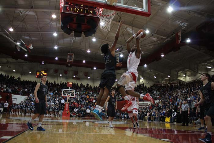 Sophomore Paul Scruggs goes up for a dunk in a game against number one in state, Evansville Reitz.