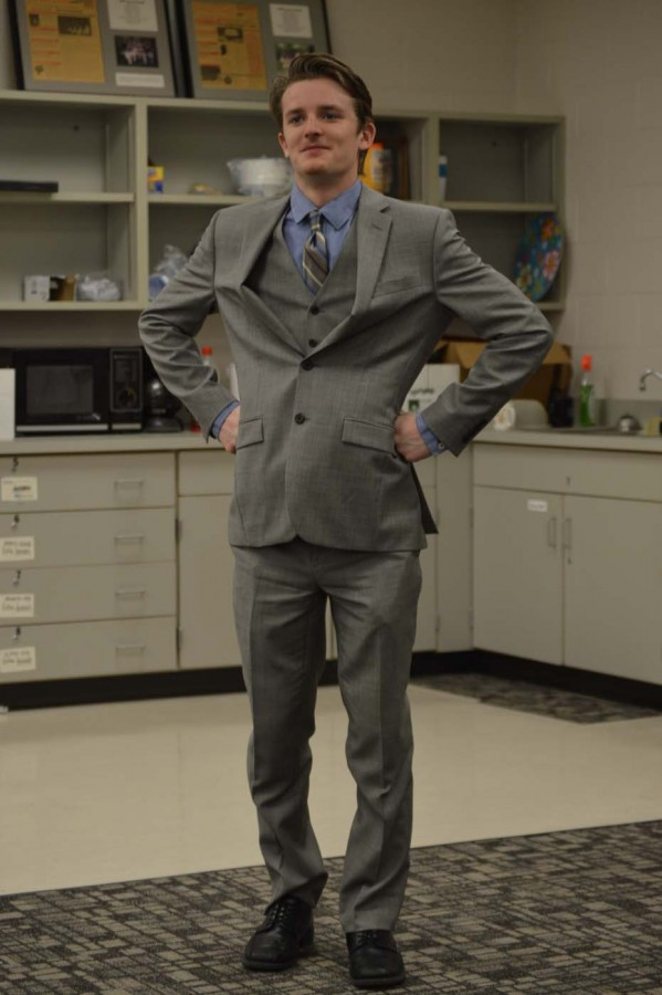 Senior Jonathan Gritt wears a suit and tie as he prepares to fight crime as Biology Man.
