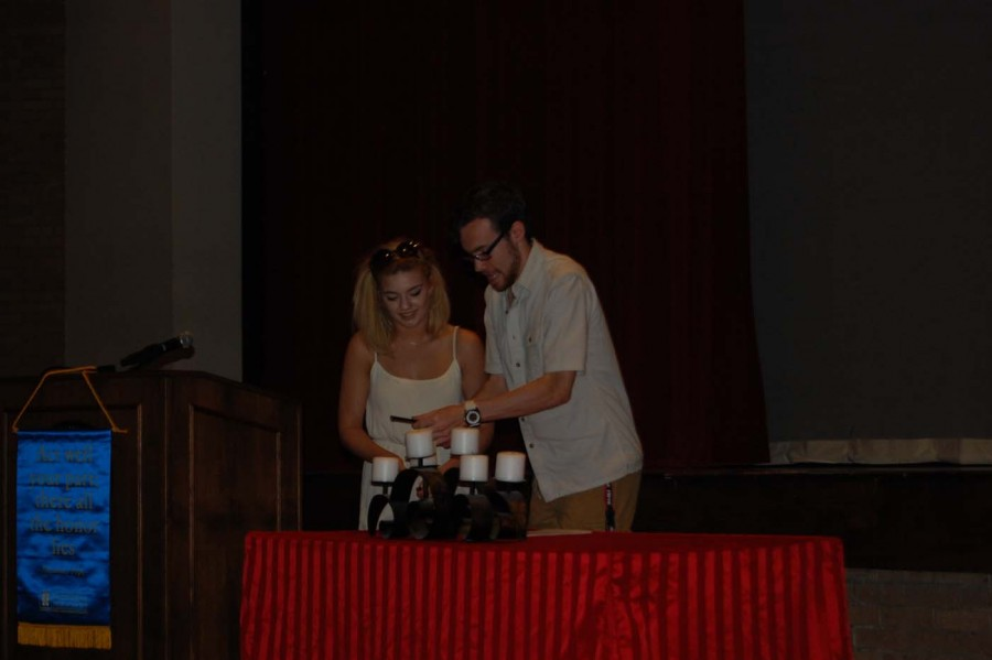Pittenger and Rose work together to light the first candle of six. This candle signified the first pillar of thespians.