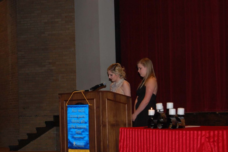 Senior Paige Kidwell speaks about about the second pillar of thespians, dance and pantomime, while senior Lydia Upton waits for her chance to speak. Kidwell and Upton told stories of their favorite memories while in theater that involved dance.