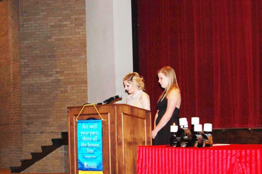 Senior Paige Kidwell speak about about the second pillar of thespians, dance and pantomime, while senior Lydia Upton waits for her chance to speak. Kidwell and Upton told stories of their favorite memories while in theater that involved dance.