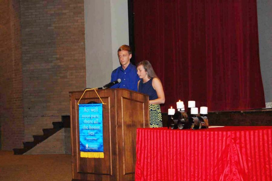 Senior Shelby Shook speaks as senior Isaac Tierney stands to her right. They spoke in honor of the fourth pillar of thespians, speech.