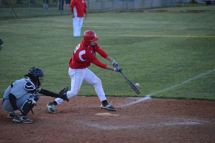 Senior Robbie Taylor gets a base hit.
