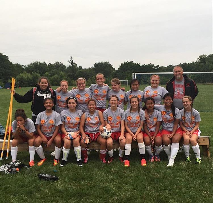 The+girls+soccer+team+poses+for+a+picture+after+finishing+a+scrimmage+at+Saint+Mary+of+the+Woods+College.+The+team+attended+a+camp+there+over+the+summer.