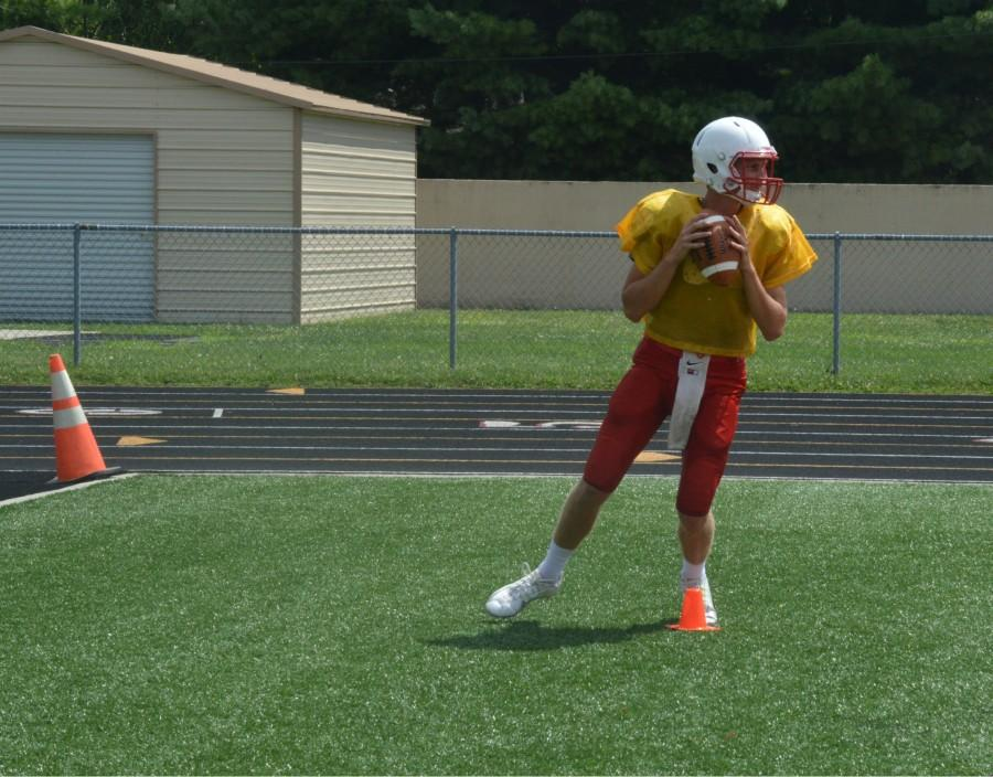 Luke Johnston '16 gets ready for the Cards' season opener. They face Roncalli at Lucas Oil Stadium on Aug. 21.