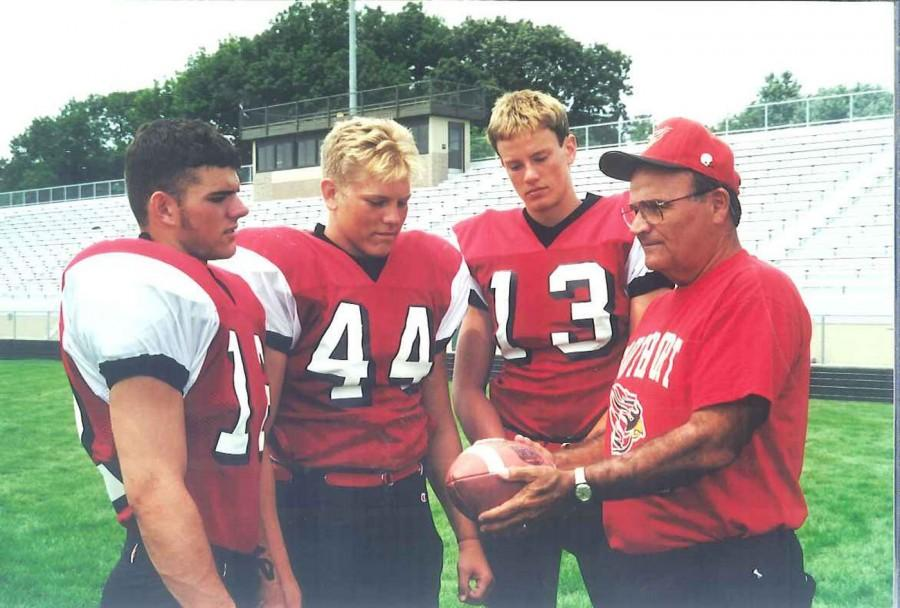 Former head coach Ken Haupt talks to player from his 2001 team. Haupt is the only coach from Southport that has been inducted to the Indiana Football Hall of Fame.