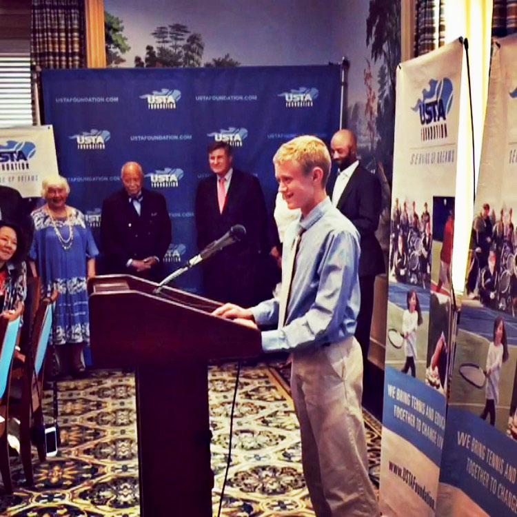 Freshman Colston Streit gives a speech thanking the USTA for his trip on Aug. 30 at the Yale Club. Attendees include former mayor of New York,  and former tennis player, James Blake.