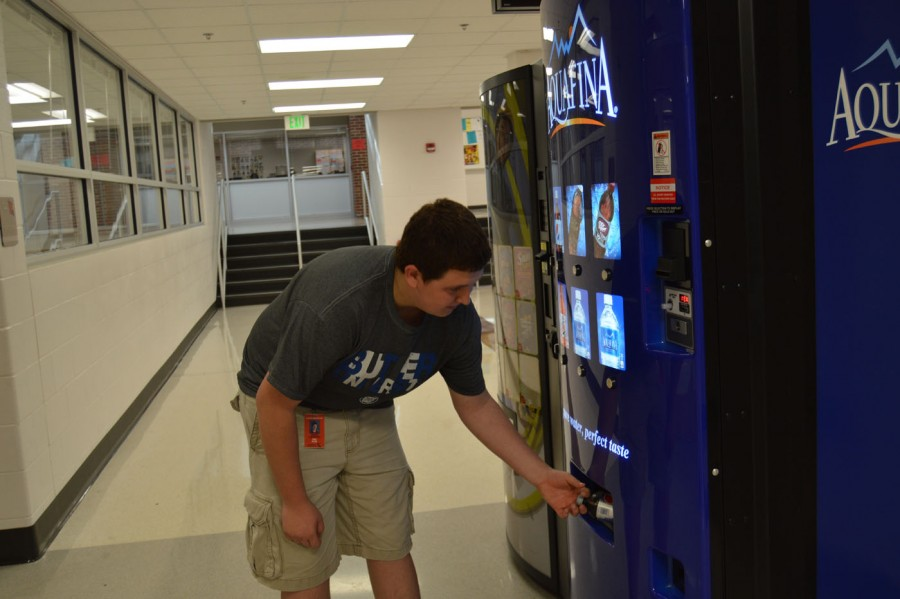 Sophomore Austin Lundsford uses one of the new vending machines sporting the new soda brand, PepsiCo.