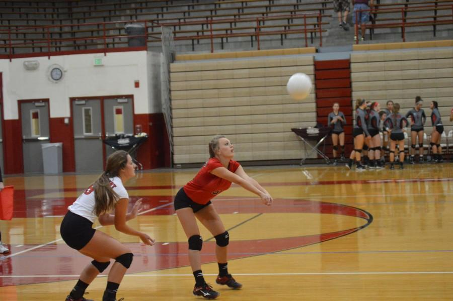 Sophomore Caroline Short passes the ball.