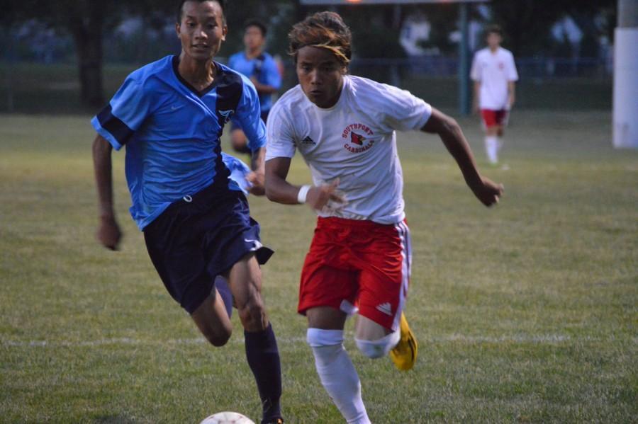 Senior Mang Lian dribbles past a Perry defender. Lian has scored 10 goals this season.