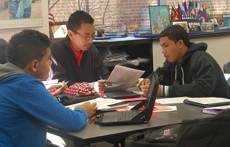 Rafael Galindo helps newcomer students in Mrs. Manning class.