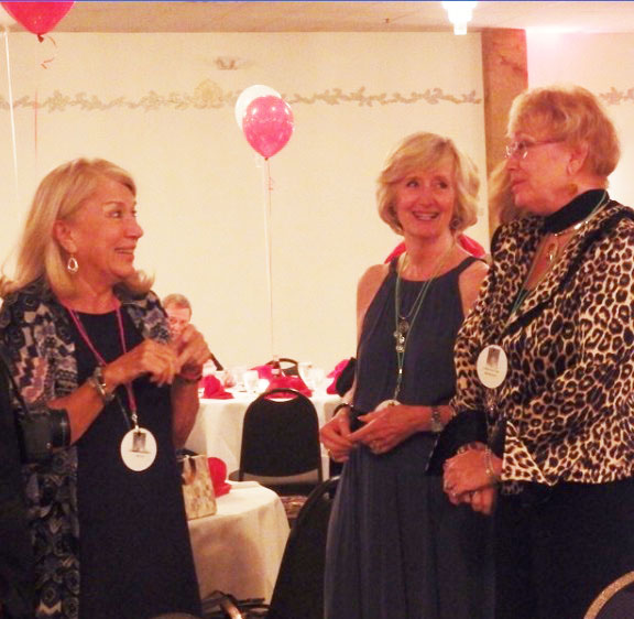 Graduates of the class of 1965 converse at the reunion on Sept. 12.