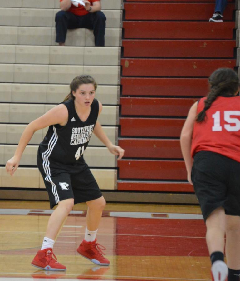 Junior Lindsay Freije plays defense against an Indian Creek guard.