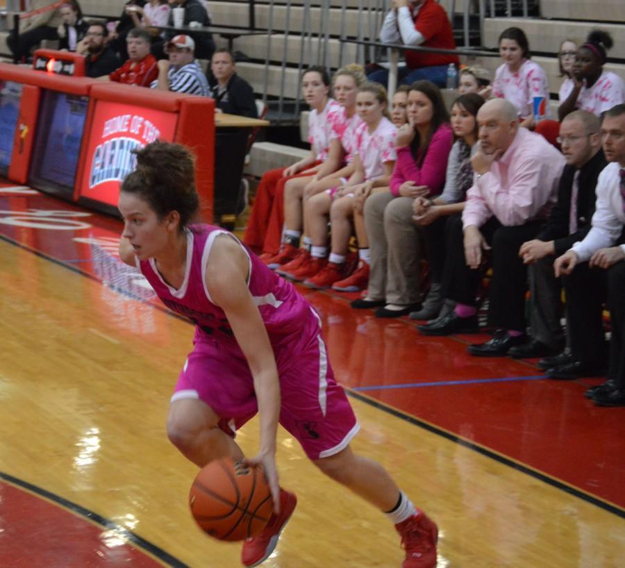 Junior Emma DeHart dribbles the ball down the baseline. DeHart scored 25 points against Avon High School.