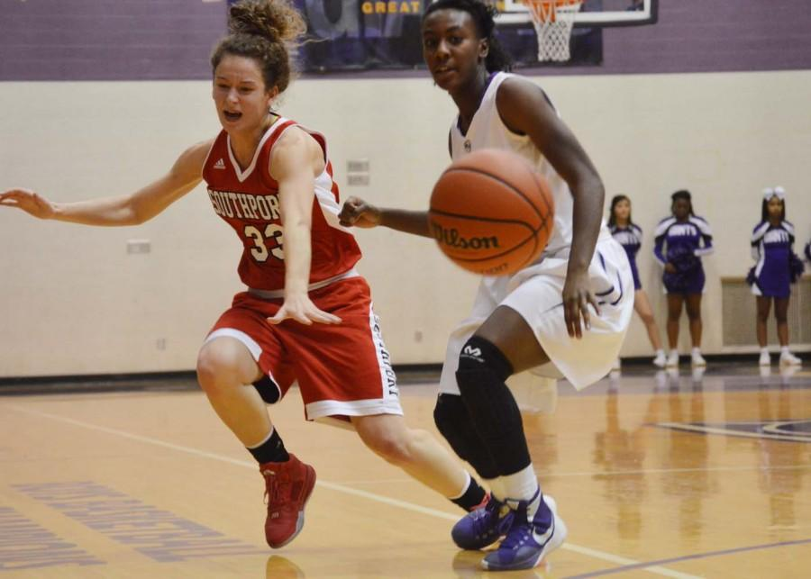 Junior+Emma+DeHart+passes+the+ball+as+a+defender+approaches+her.+%0AThe+defensive+pressure+was+intense+the+whole+game.+