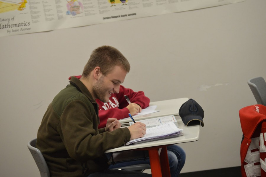 Junior Jacob Jackson reviews for his Algebra 2 final in James O'Brien's class on Dec. 14.