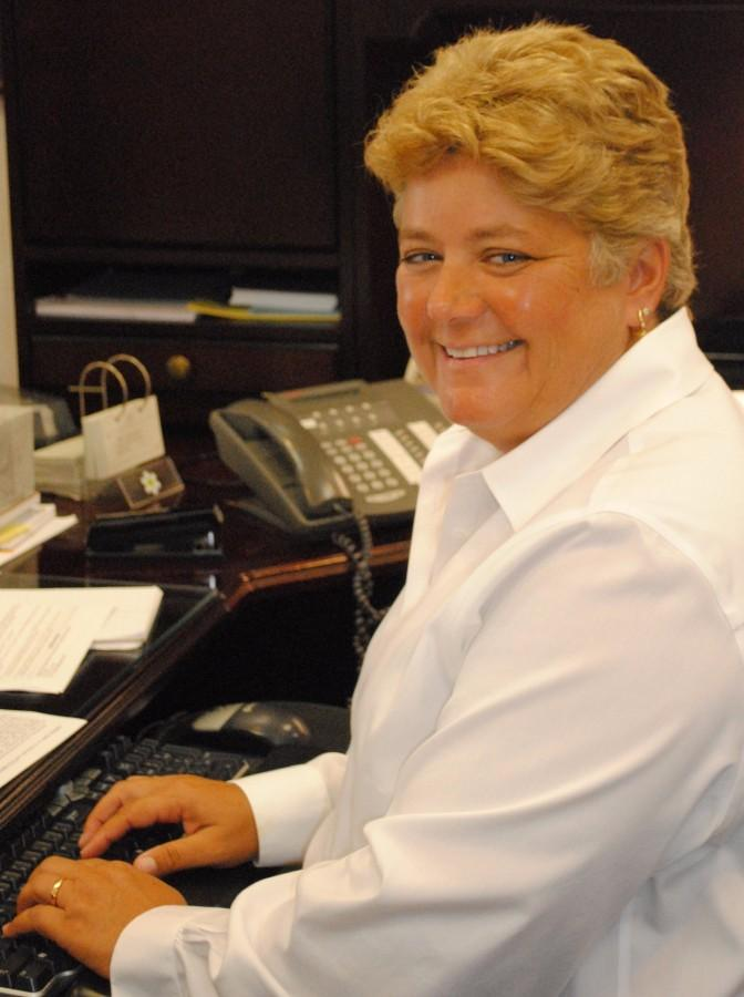 Barb Brouwer, shown here at her desk in 2011, announced her retirement during a staff meeting on Jan. 11. Brouwer will retire at the end of the year.
